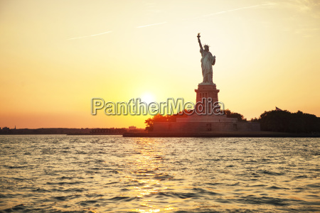 statue of liberty and river against