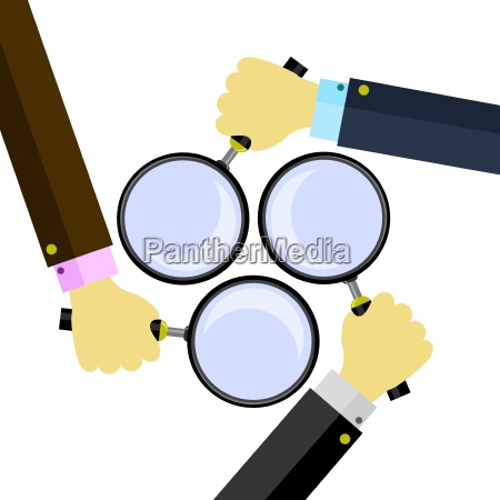 magnifying glass with reflection and hand