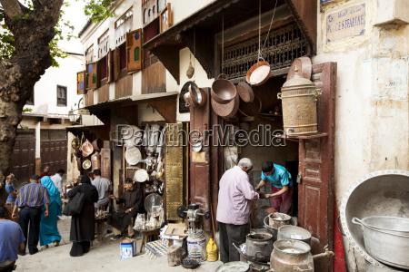 customers at market stall in pushkar