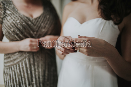 midsection of bride wearing wedding dress