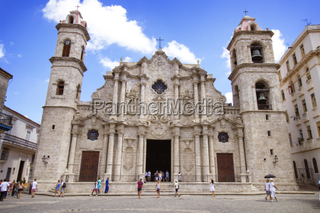 tourists outside havana cathedral against sky