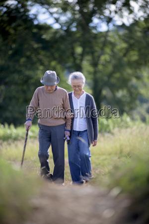 husband and wife elderly man wearing