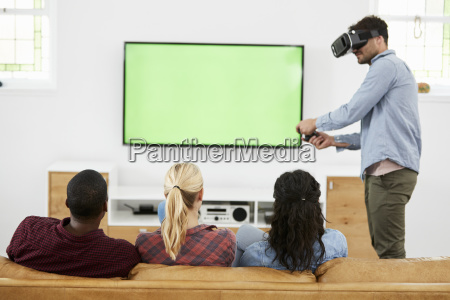 friends playing computer game with virtual