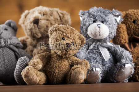 cute teddy bears on wooden background