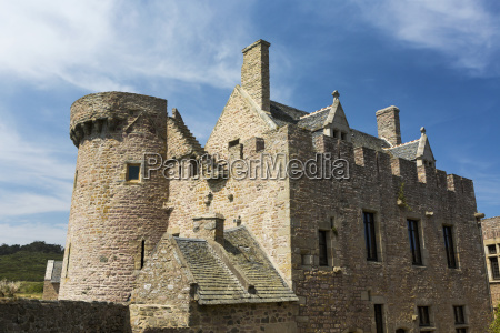 old stone fort with turret and