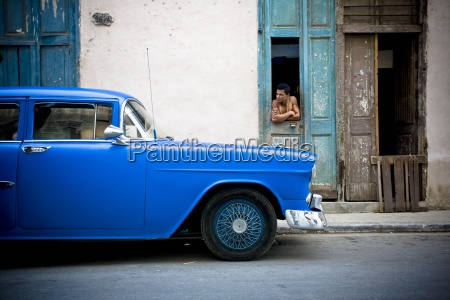 parked blue car on street in