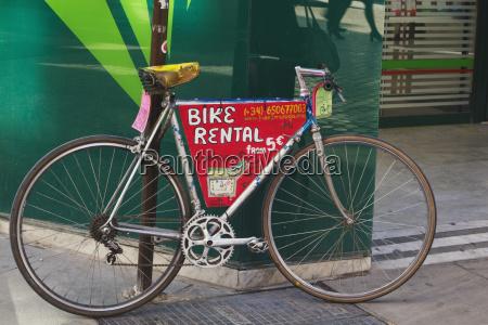 bicycle parked in street advertising bike