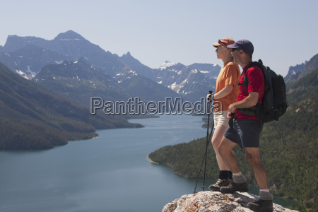 male and female hiker standing on