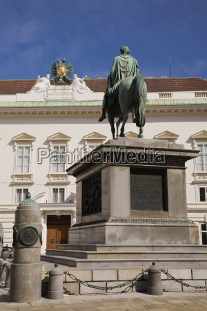 statue and old architectural style building