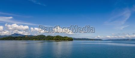 coastline with blue sky and blue