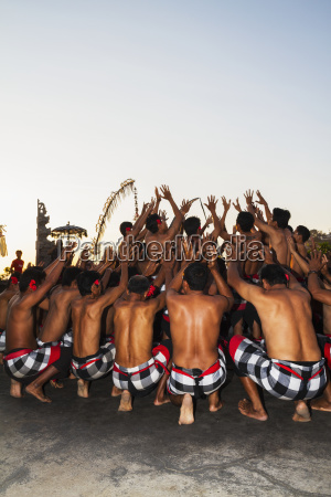 men dance in a circle chanting