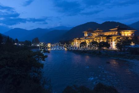 punakha dzong illuminated at dusk punakha