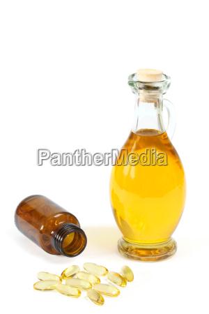 vitaminkapsler med olieflaske