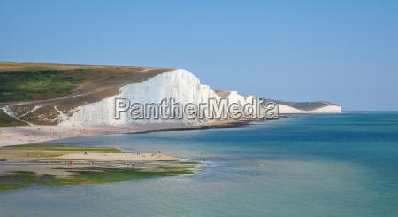 seven sisters cliffs seascape og mennesker