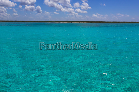 the coastline with blue caribbean water