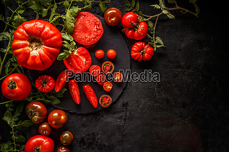 fresh red sliced and whole tomatoes