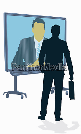 businessman talking to co worker on