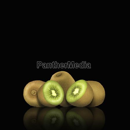 ganze und geschnittene kiwi fruechte