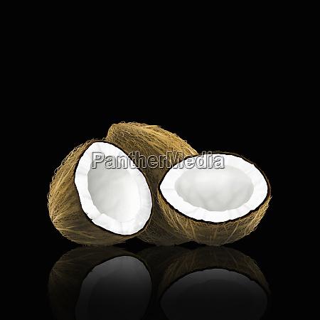 ganze und halbierte kokosnuss