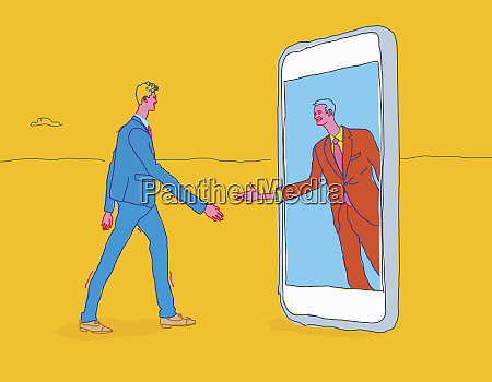 two businessmen meeting and shaking hands