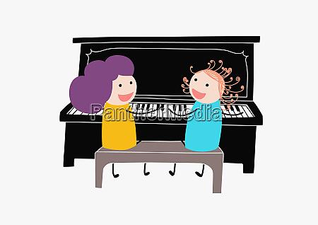 born som spiller duet pa klaver