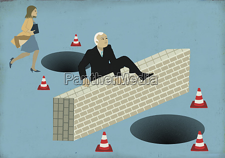 businessman and businesswoman facing pitfalls and