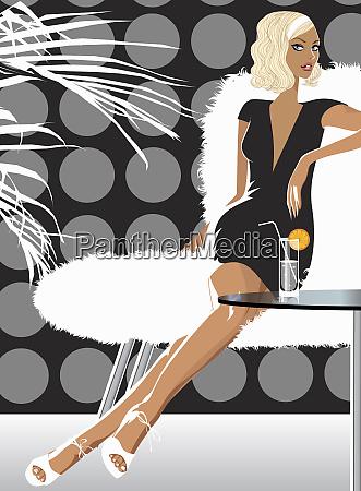 woman having drink in stylish lounge