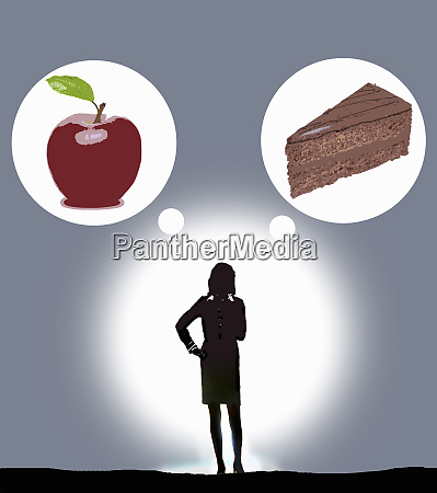 woman deciding between healthy apple and