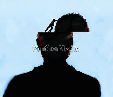 man opening top of mans head
