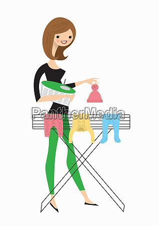 kvinde haengende babytoj pa airer