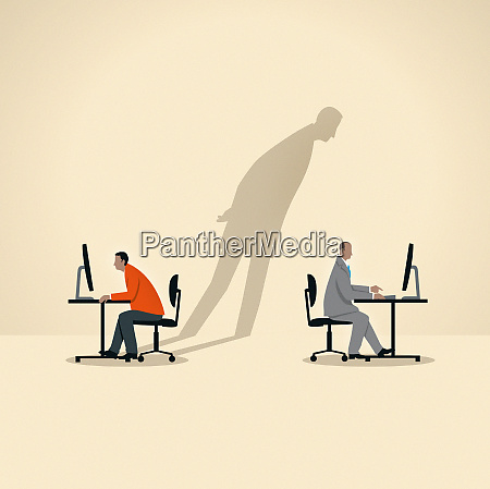 shadow of businessman spying on colleague