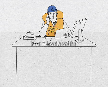 businessman on phone wearing hard hat