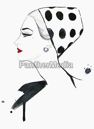 elegant woman wearing polka dot pillbox