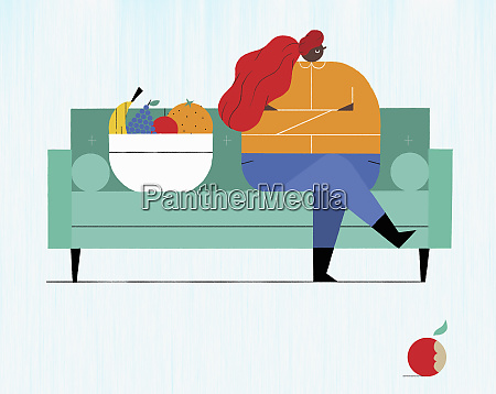 displeased overweight woman sitting on sofa