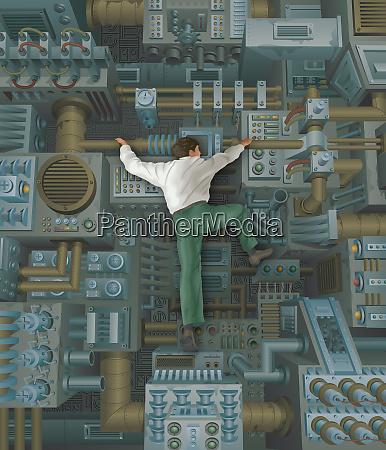 businessman climbing inside of large machine