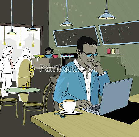 businessman working in cafe using laptop