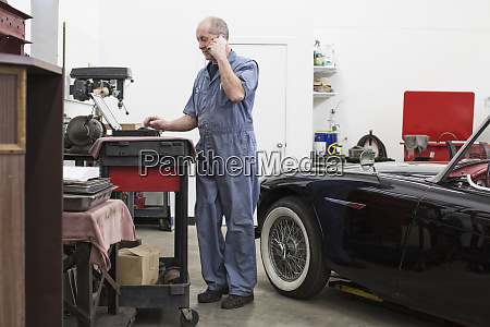 a senior caucasian male car mechanic