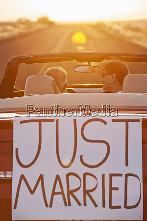 a senior couple just married riding