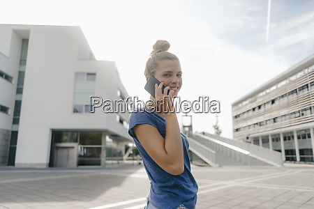netherlands maastricht smiling young woman on