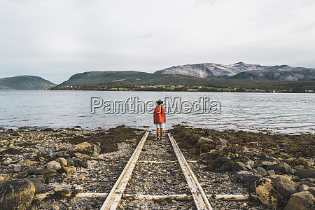 northern norway man standing alone at