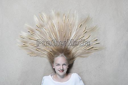 portrait of smiling girl lying on
