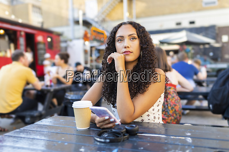 beautiful young woman with cell phone