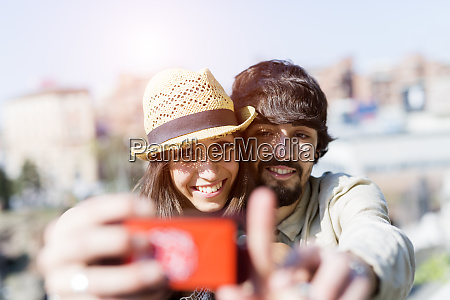 portrait of happy young couple taking