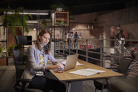 businesswoman working in modern office using