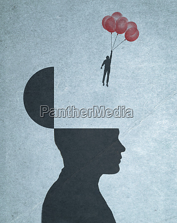 man holding bunch of balloons floating