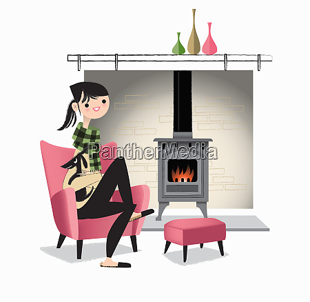 woman cosy next to wood burning