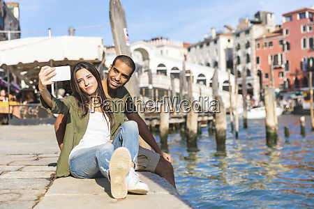 italy venice couple relaxing and taking