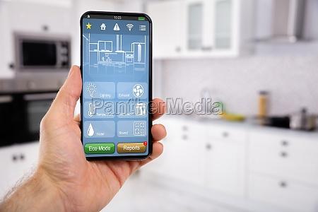 hand holder mobil med smart home