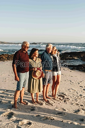 senior couples enjoying sun on sandy