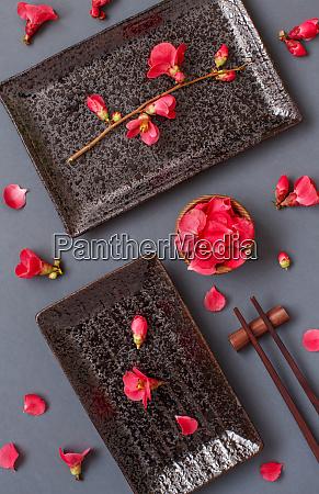 chopsticks rectangular plates and pink flowers